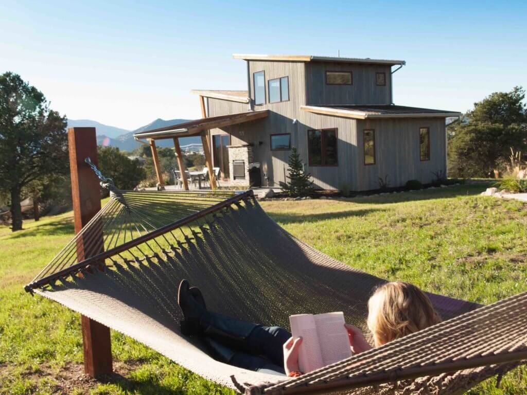 A glamper relaxes at Royal Gorge Cabins • Photo courtesy of Royal Gorge Cabins